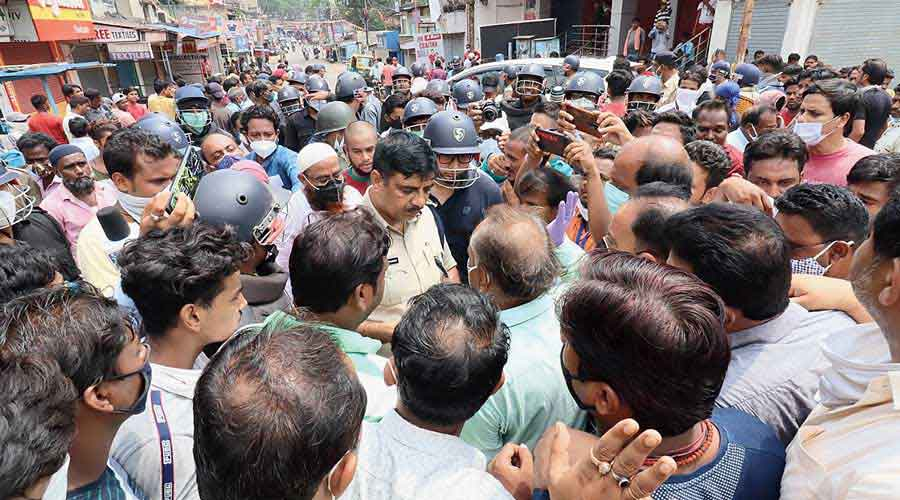 The police try to pacify the protesters at Barakar in West Burdwan on Tuesday.