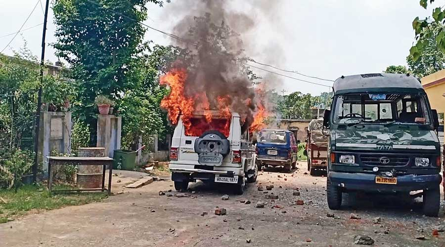 A vehicle set ablaze in the violence.