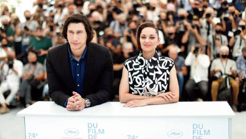 Adam Driver and Marion Cotillard at the photocall for their film Annette on the opening day of the Cannes Film Festival on July 6