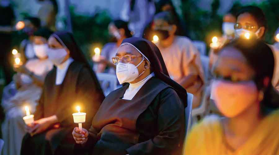 People pay homage to Father Stan Swamy at a condolence meet  in Bangalore on Wednesday