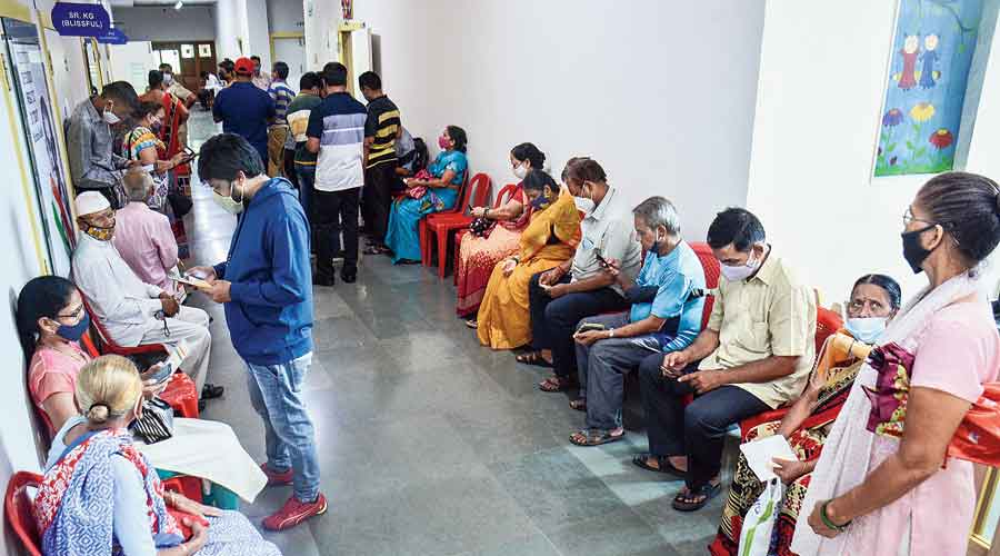 Beneficiaries wait to receive  Covid-19 vaccine dose  at a vaccination centre in Thane, Maharashtra, on Wednesday