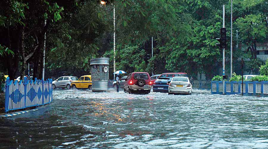 Vehicles negotiate a waterlogged stretch near Raj Bhavan on Wednesday.
