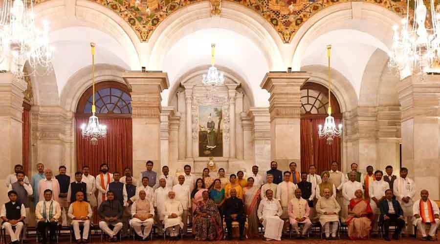 President Ram Nath Kovind, First Lady Savita Kovind, Vice President M Venkaiah Naidu, Prime Minister Narendra Modi and Lok Sabha Speaker Om Birla in a group photograph with the newly sworn-in Council of Ministers, at the Rashtrapati Bhavan
