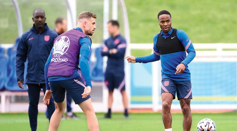 Jordan Henderson and Raheem Sterling during practice at St George's Park on Saturday, the eve of the Euro 2020 final