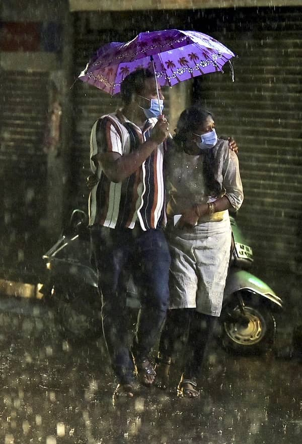 People during heavy rain at Malakpet in Hyderabad on Monday