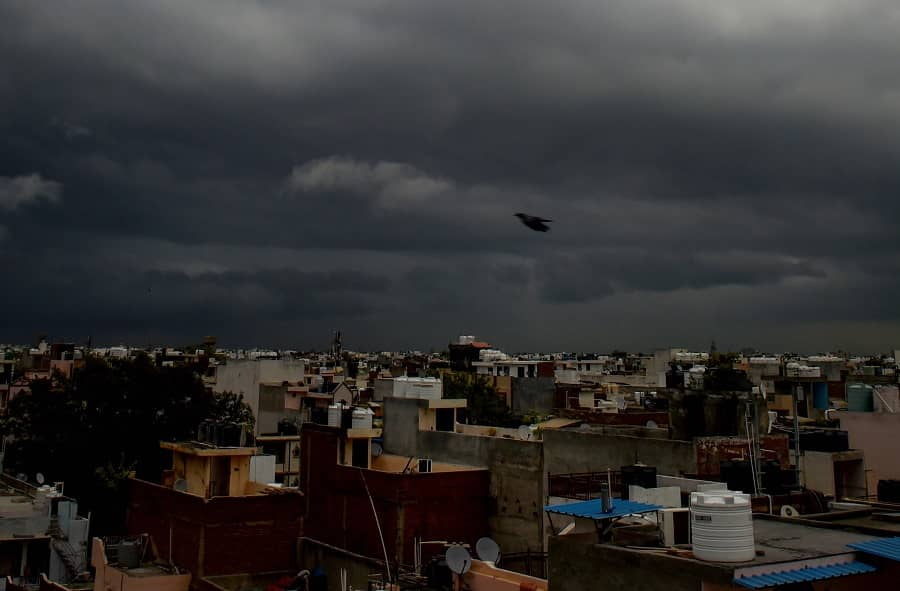 Monsoon clouds hover in the sky in New Delhi on Tuesday