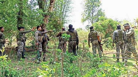 Security forces during the search operation at the forest in Gumla on Wednesday