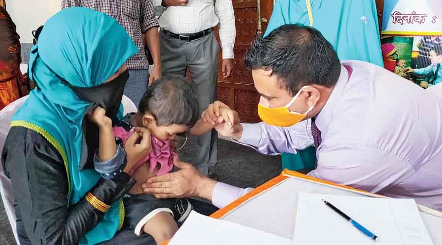 Dr Kafeel Khan examines a child at Haj House in Ranchi on Thursday.