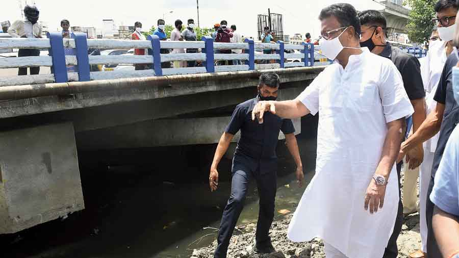 Firhad Hakim inspects a canal that drain out water from Jadavpur and Kasba on Thursday.
