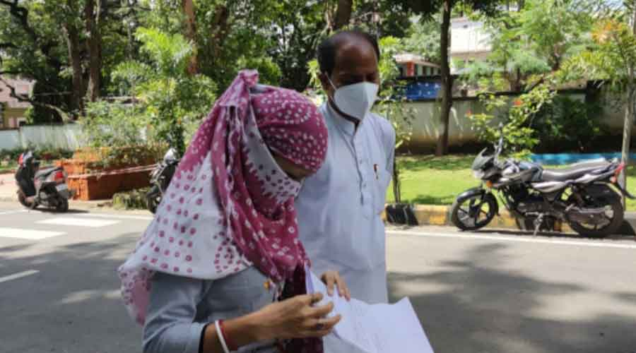 The victim with a relative near the senior SP's office in Bistupur on Friday.