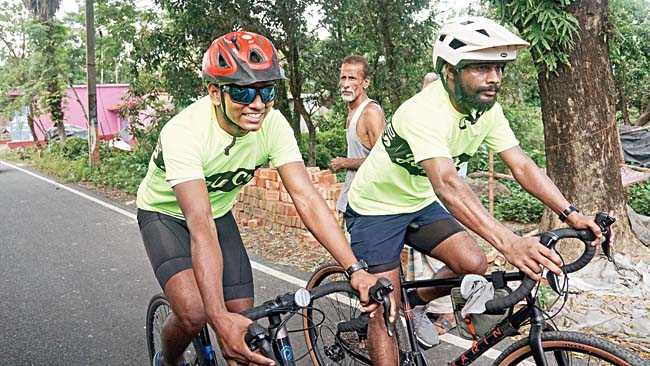 Pedal power: Sunny from Cycle Logic (left) and Pratap from Jungle Crows