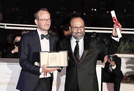 Film-makers Juho Kuosmanen (left) and Asghar Farhadi who shared the Grand Prix