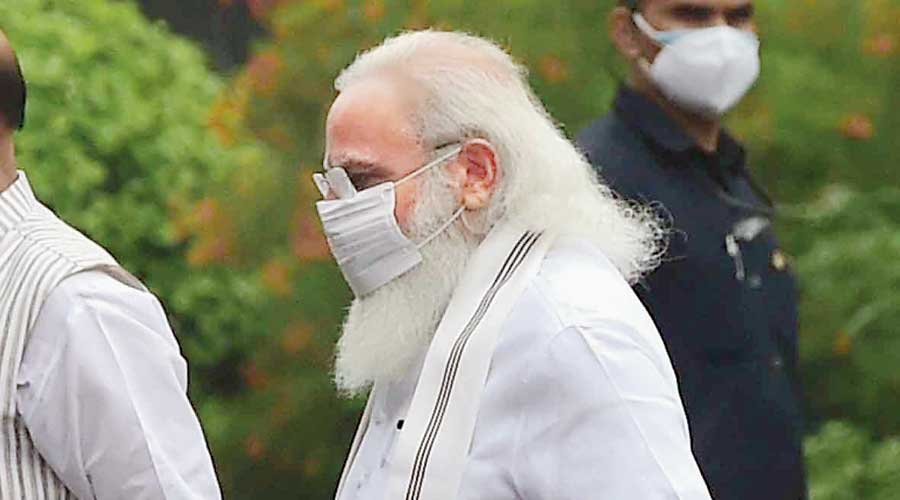 Prime Minister Narendra Modi after the BJP parliamentary party meeting  in New Delhi on Tuesday. Modi made no direct references to  the Pegasus controversy. Unwittingly or otherwise, the  sole nod to the scandal was  his pristine  white attire. Pegasus, the winged horse  in Greek mythology,  is usually  depicted  in white.