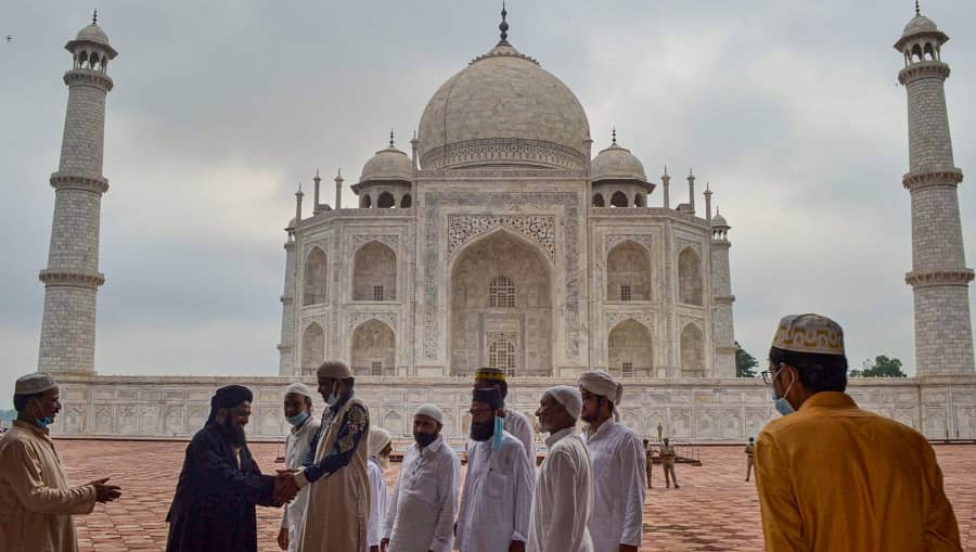 Muslims greet each other on the occasion of Eid al-Adha, at Taj Mahal complex, in Agra on Wednesday.