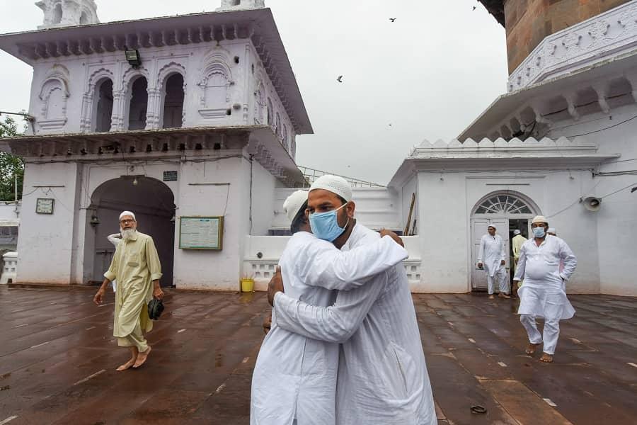 Muslim devotees greet each other after Eid-al-Adha prayers at Jama Masjid in Bhopal on Wednesday.