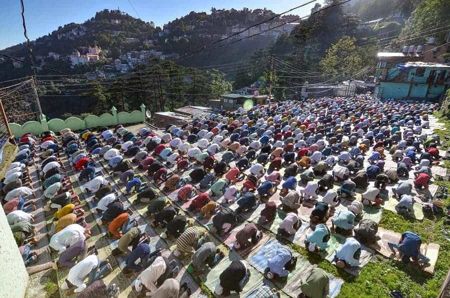 Muslim devotees offers Eid-al-Adha prayer at Lakkar Bazar in Shimla on Wednesday.