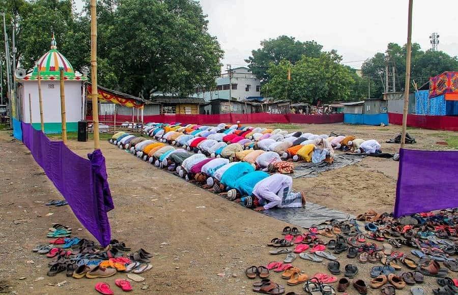 Devotees offer prayers at Eidgah maidan near Balurghat on Wednesday.