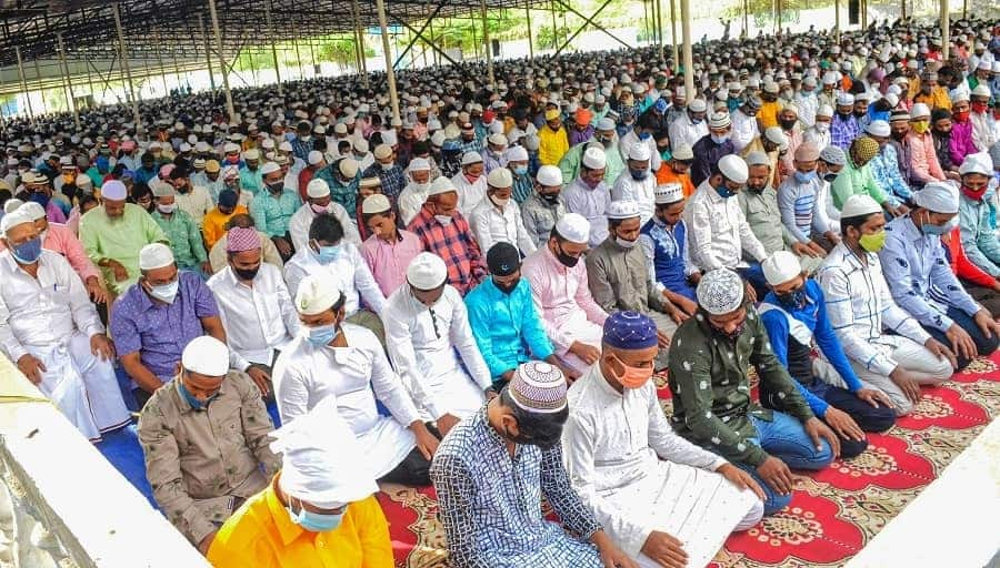 Muslims offer prayers at a market, in Coimbatore on Wednesday.