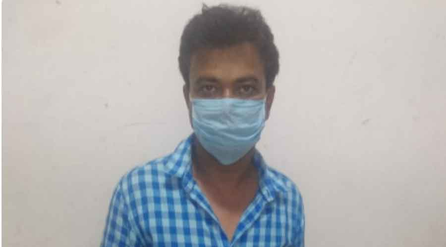 Munna Singh in police custody in Kadma thana on Wednesday.