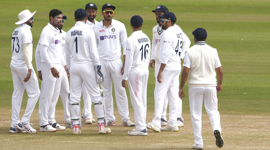 Umesh Yadav (second from left) celebrates with teammates after taking the  wicket of Jake Libby  on Wednesday.
