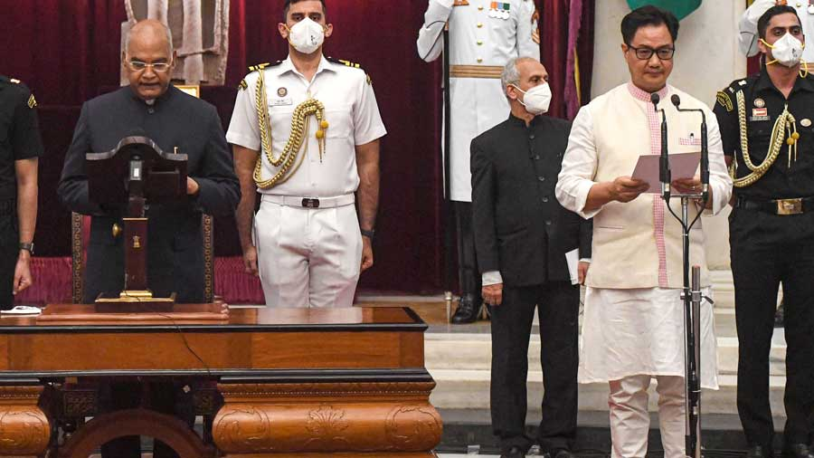President Ram Nath Kovind administers oath of office and secrecy to cabinet minister Kiren Rijiju, at a ceremony at Rashtrapati Bhavan in New Delhi, Wednesday, July 7, 2021.