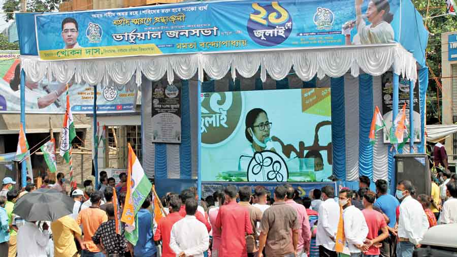 Trinamul supporters in Burdwan on Wednesday watch Mamata speak at the Martyrs' Day rally virtually.