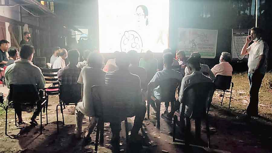 Tripura Trinamul workers watch the recording of Mamata Banerjee's Martyrs' Day message on Wednesday evening on a giant screen at the party's Dharmanagar  office.