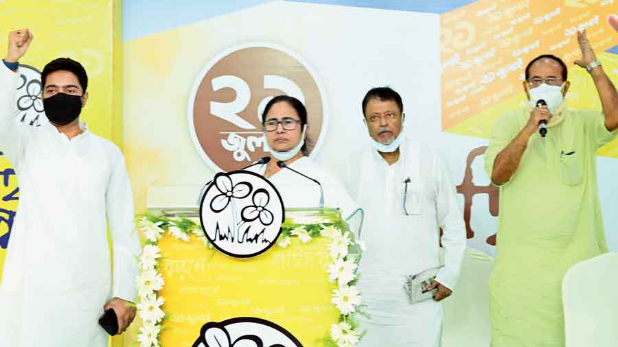 (From left) Abhishek Banerjee, Mamata Banerjee and Mukul Roy at the Martyrs' Day event in Calcutta on Wednesday