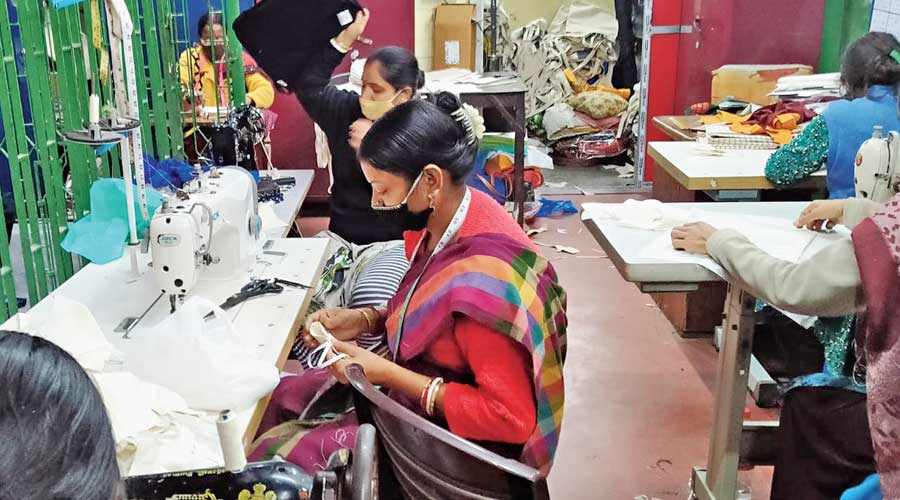 Women work at a craft centre run by Calcutta Social Project