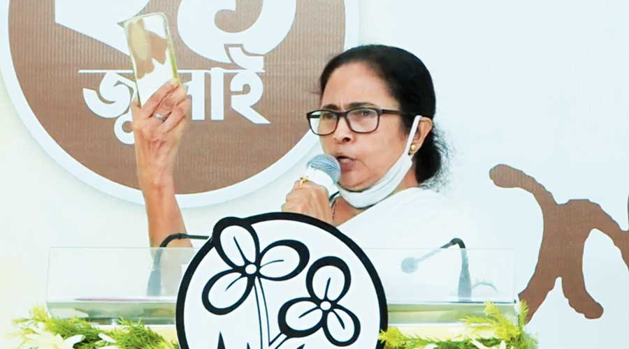 """Mamata Banerjee holds up her phone and, addressing the leaders  of other Opposition parties listening to her from Delhi, says she has taped over the cameras of her phone because of the possibility of being targeted with spyware. She said the Modi government needs to be """"plastered up"""" in  a similar manner to prevent the destruction of the country"""