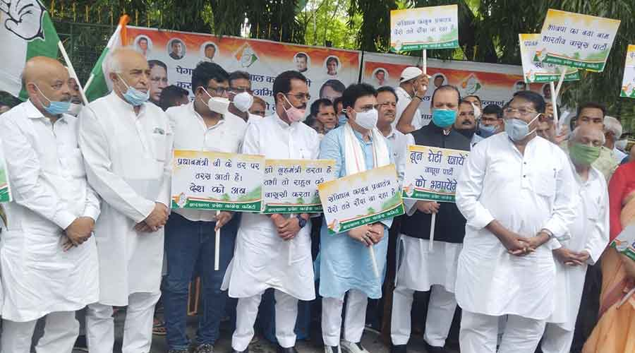 Congress supporters hold a sit-in at Raj Bhavan to demand a judicial probe into the Pegasus snooping controversy in Ranchi on Thursday.