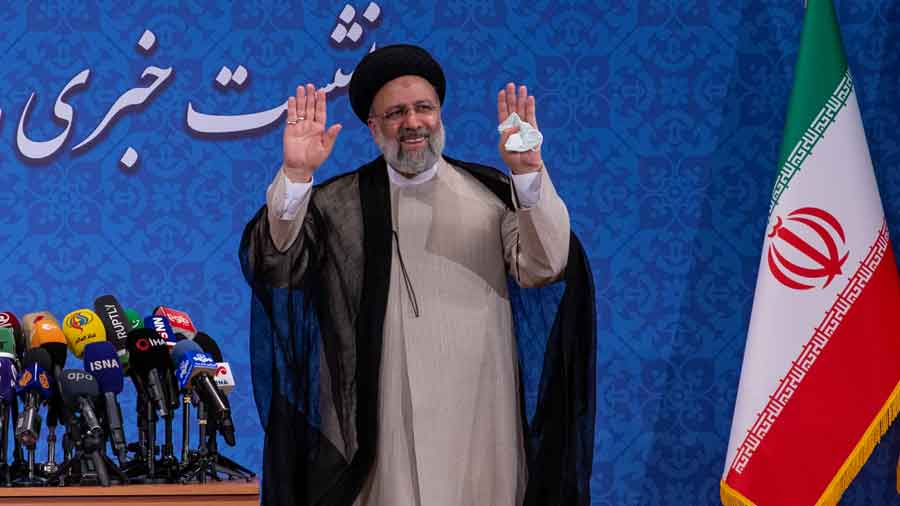 Iran's President-elect Ebrahim Raisi arrives at his first news conference in Tehran, Iran, on Monday, June 21, 2021