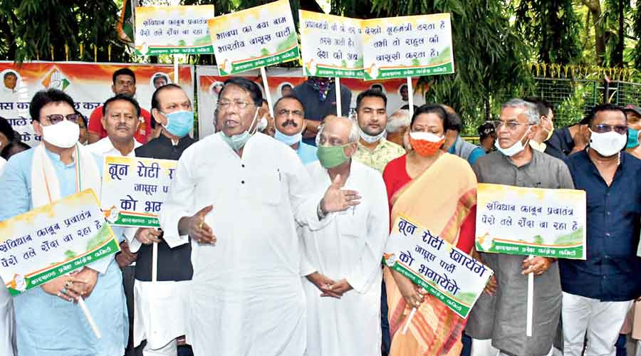 Jharkhand  Congress chief and finance minister Rameshwar Oraon (left) at the protest at the Raj Bhavan in Ranchi on Thursday.