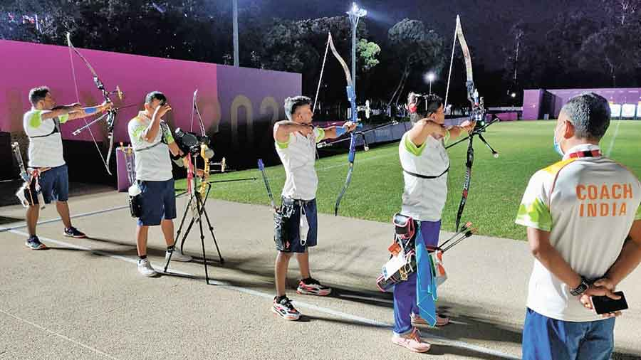 India archers in Tokyo practise under flood lights on Wednesday. They begin their competition on Friday.