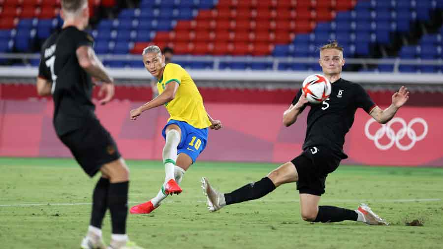 Richarlison completed his hat-trick with a superbly taken solo goal, curling the ball into the far corner after being set up by Matheus Cunha.
