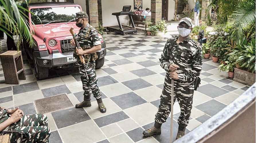 Security personnel guard the residence of Dainik Bhaskar Group owner Sudhir Agarwal after income tax sleuths searched the premises in Bhopal on Thursday.