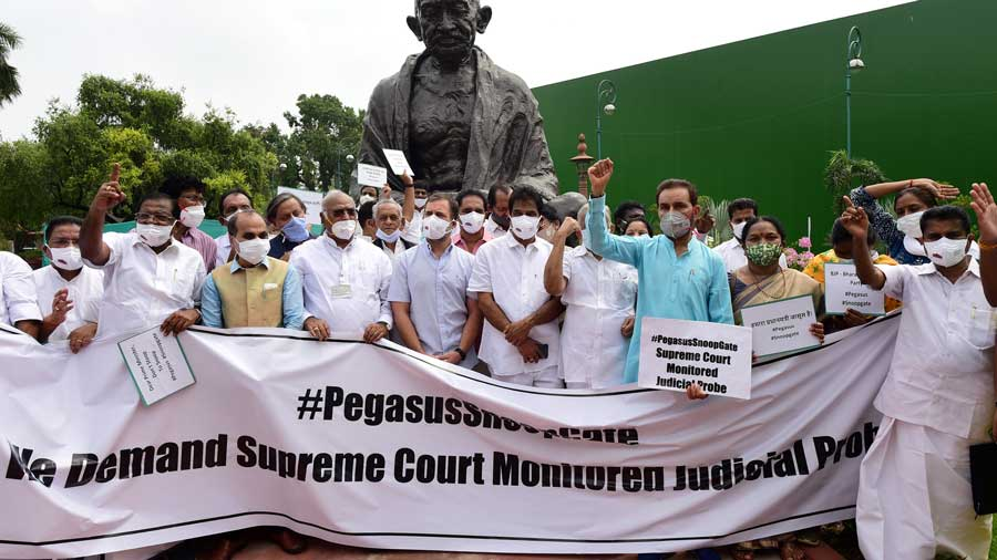 Congress leader Rahul Gandhi with party leaders, DMK and other parties MPs stage a protest near the Gandhi statue against Pegasus project, during the Monsoon Session of Parliament, in New Delhi, Friday, July 23, 2021.
