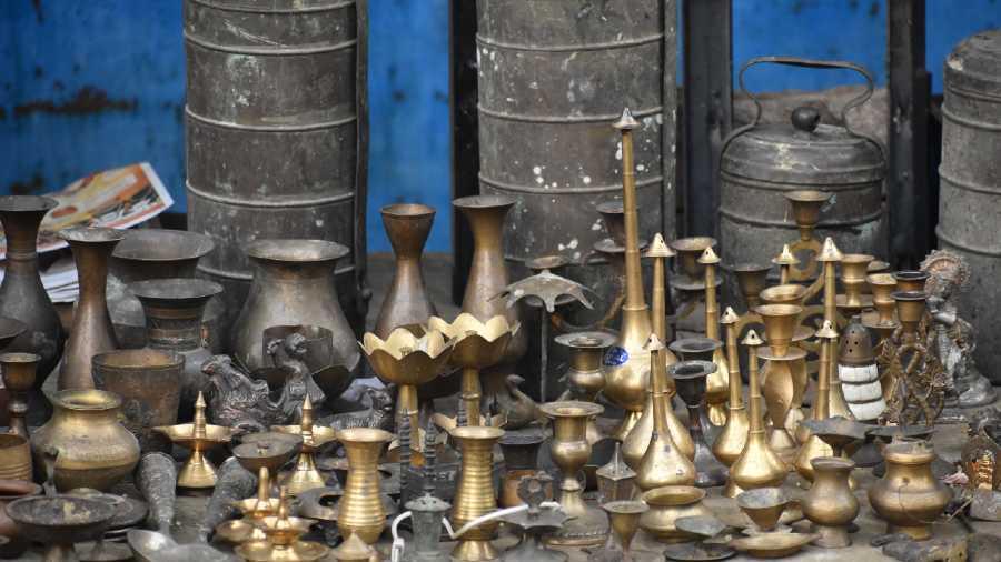 A roadside kabadi shop has metal items on display.