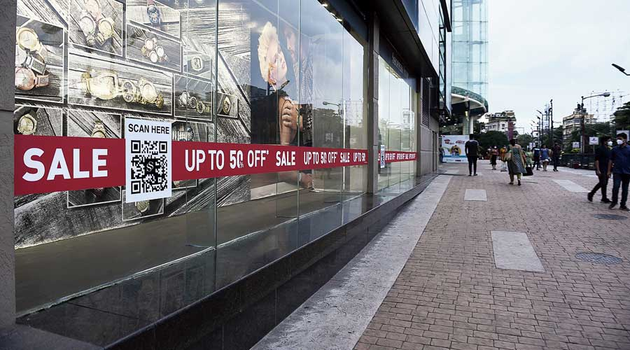 Sale signs on show windows outside South City Mall on Friday