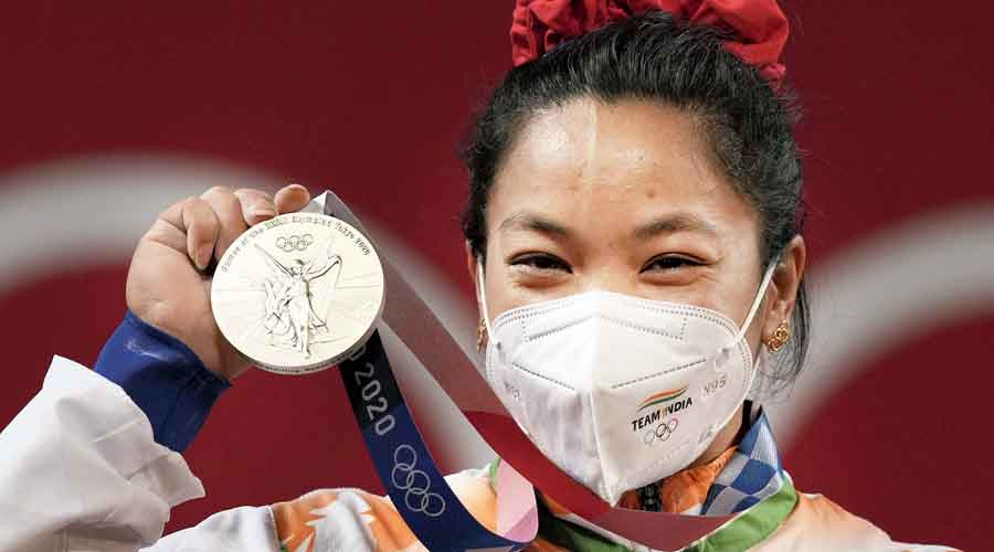 Mirabai Chanu stands on the podium after receiving the silver medal in the women's 49kg category weightlifting event at the  Olympics in Tokyo on Saturday.