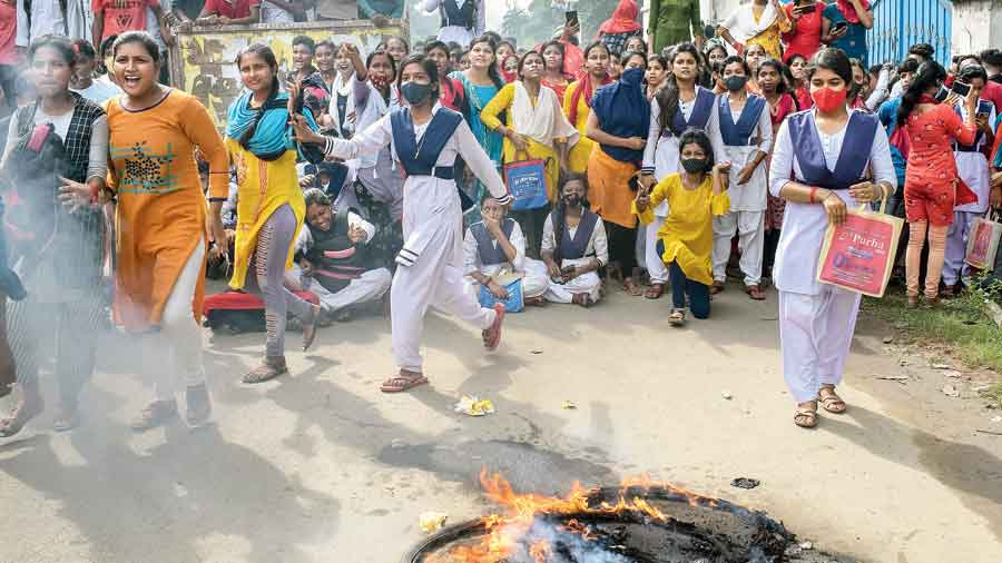Students of Nadia's Santipur Bagh Anchra high school  who failed in the higher secondary examination protest  on the Santipur-Nabadwip road on Friday