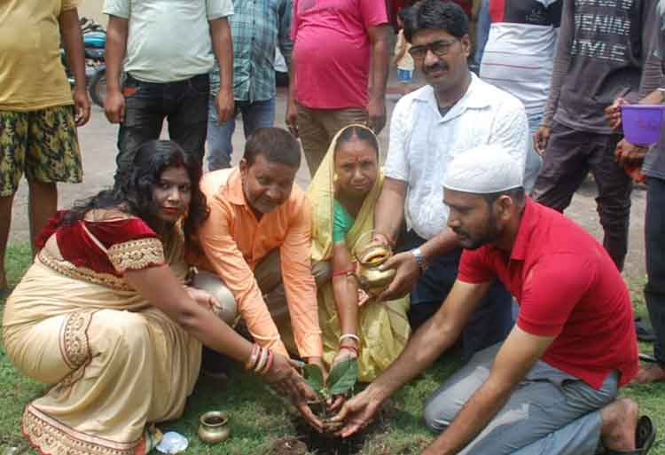 Members of social organisations and devotees plant saplings on the occasion of Sawan on Nilakanth Mandir at Rajagadh, Jharia on Sunday.