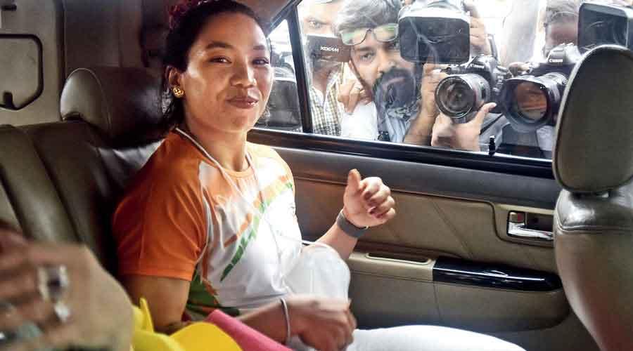 Mirabai Chanu at the Delhi airport on Monday.
