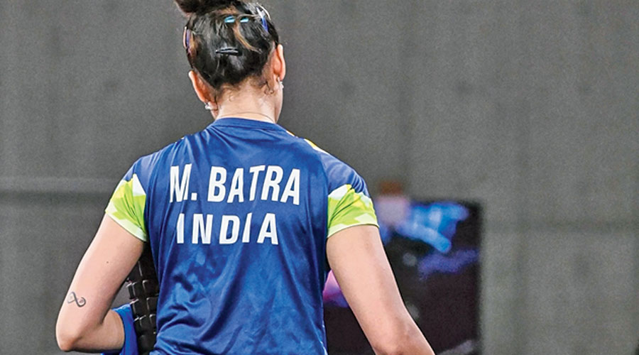 Manika Batra leaves  the field of play on Monday after losing to Sofia Polcanova.