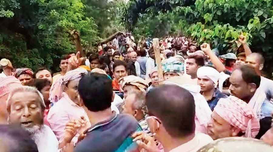 Trinamul supporters demonstrate in Harishchandrapur of Malda district on Tuesday after the kidnap.