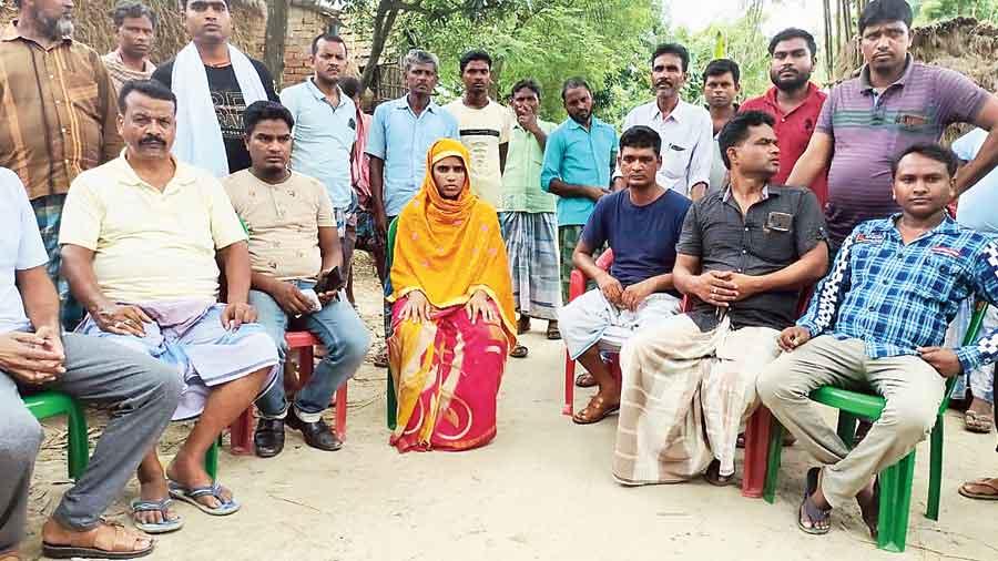 Some of the rescued Trinamul members of Daulatnagar panchayat at Harishchandrapur in Malda on Wednesday.