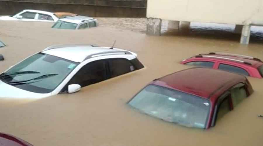 Cars under water in a flooded parking lot of an apartment complex at Kathal More in Ranchi on Saturday.