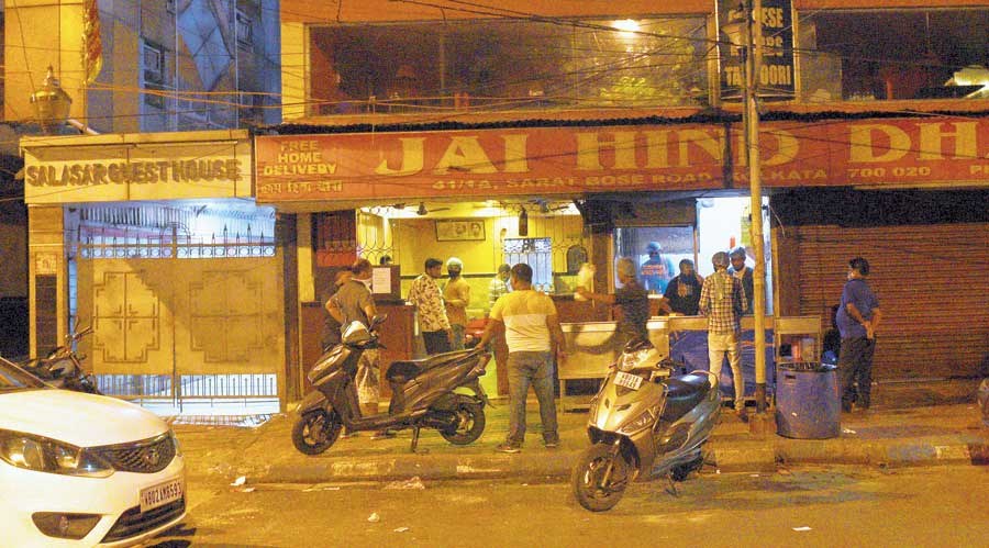 Customers outside an eatery on Sarat Bose  Road on Friday night