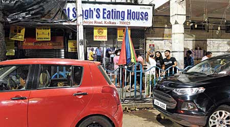 Customers  in front of a dhaba on Harish Mukherjee Road and (below) a few