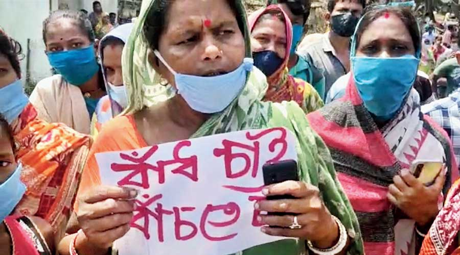 A villager with a placard at Abhishek's meeting.